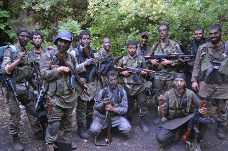 اتهام عناصر «مجاهدي المغرب الاسلامي» بإدخال أسلحة و متفجرات من ليبيا عبر موريتانيا والجزائر  و بإقامة معسكر «الكرار» كقاعدة خلفية بسهب  الحرشة بنواحي طانطان