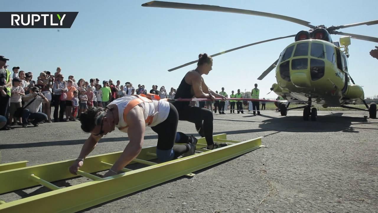 أقوى امرأة في روسيا تسحب مروحية وزنها 8.6 طن
